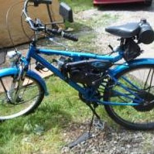 2011 STILL RIDING DAILY pearl blue with ghost flames averaging 100 miles a week this bike goes were I go, powered with a Suzuki JR 50 2 stroke motor,u