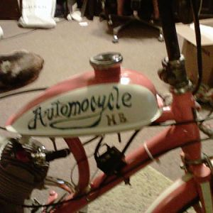 "Hand-painted ""Automocycle HB"" logo on tank. (""Automocycle"" was inspired by Futurama; ""HB"" is in paying homage to the original ""Hyda Bike"")."