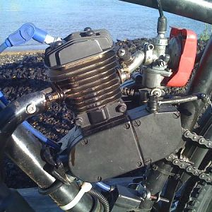 skyhawk 66cc with speed carb ported intake and exhaust,gutted exhaust pipe ,msd spark plug wire ,boost bootle