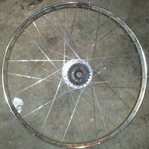 The finished wheel!  11 gauge spokes on a puch hub, going to a m.o manufacturing rim.   Should hold up for a while.