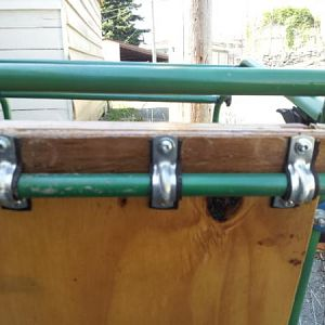 "The front and back bars of the trailer are smaller in diameter, and set at a slightly different hieght to the middle bar.  There is a 1/4"" plywood shi"
