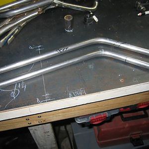 "Rods from front axle rocker to spring..these are solid 1/2"" rod are bent at 45 deg to spring hangers...this is before I cut them to weld to the spring"