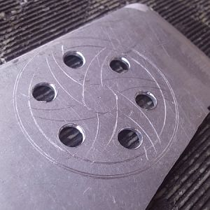 Pulley cover drawn on piece of aluminum and pilot holes drilled.....