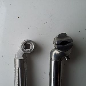 Replacement and Original seat posts, left and right respectively.