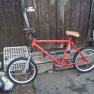 "next platform...19"" frame, 20"" wheels sledgehammer front forks...19"" rise monkey bars, old school persons seat, friction drive?"